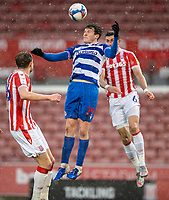 6th February 2021; Bet365 Stadium, Stoke, Staffordshire, England; English Football League Championship Football, Stoke City versus Reading; Tom Holmes of Reading heads the ball clear
