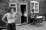 """Miner, Clive Backhouse and family. Carol Backhouse with new baby Craig. Two children in the back doorway are Tracy and Kathleen Whitehall. Northfield estate, South Kirkby. South Kirkby colliery Yorkshire England. 1979.<br /> After the pit closed Clive worked as an odd job man to provide for his family. """"He is still in the little village of South Kirkby in his little bungalow. South Kirkby has changed, sadly its not the same."""" Info thanks to Theresa Whittaker Clive's stepdaughter."""