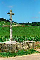 The stone cross marking the Romanee Conti and Richebourg vineyards of Domaine de la Romanee Conti in Vosne Romanee, Bourgogne