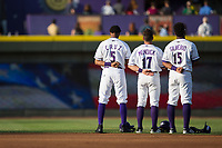 (L-R) Winston-Salem Dash teammates Johan Cruz (5), Danny Mendick (17), and Louis Silverio (15) stand for the National Anthem prior to the game against the Buies Creek Astros at BB&T Ballpark on April 15, 2017 in Winston-Salem, North Carolina.  The Astros defeated the Dash 13-6.  (Brian Westerholt/Four Seam Images)