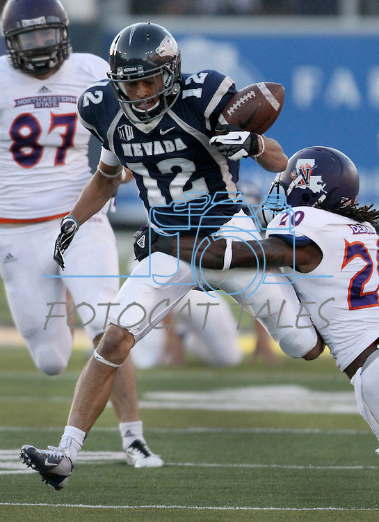 Northwestern State's Ryan Sorrell (20) forces Nevada's Richy Turner (12) to fumble during the second half of an NCAA college football game Saturday, Sept. 15, 2012, in Reno, Nev. (AP Photo/Cathleen Allison)