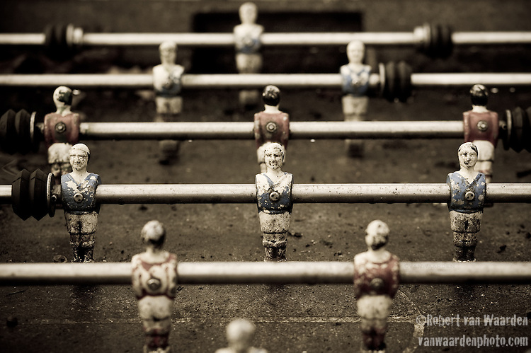 A well used Foozball game in Rennes, France.