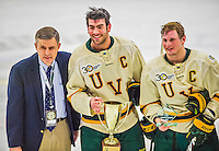 29 December 2013:  University of Vermont Catamount Defenseman Michael Paliotta (center), a Junior from Westport, CT, and Forward H.T. Lenz (right), a Senior from Vienna, VA, the team co-captains, accept the tournament awards after the final game against the Canisius College Golden Griffins at Gutterson Fieldhouse in Burlington, Vermont. The Catamounts defeated the Golden Griffins 6-2 to capture the 2013 Sheraton/TD Bank Catamount Cup NCAA Hockey Tournament for the second straight year. Mandatory Credit: Ed Wolfstein Photo *** RAW (NEF) Image File Available ***