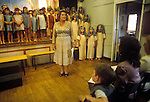 Junior school end of year school playa. Headteacher addressing the parents at the end of the performance.  Private education 1990s UK