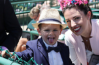 30th April 2021; Kentucky, USA;  A mother with her son pose for a photo during Oaks Day on April 30, 2021 at Churchill Downs in Louisville, Kentucky.