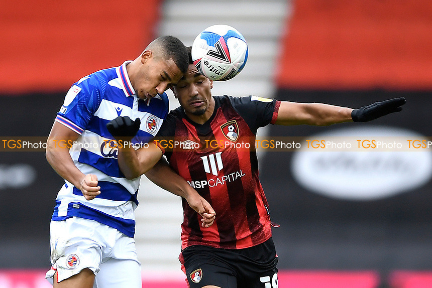 Andy Rinomhota of Reading left wins a header from Junior Stanislas of AFC Bournemouth during AFC Bournemouth vs Reading, Sky Bet EFL Championship Football at the Vitality Stadium on 21st November 2020