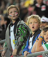 Fans watch a replay during the ANZAC Day AFL match between St Kilda Saints and Brisbane Lions at Westpac Stadium, Wellington, New Zealand on Friday, 25 April 2014. Photo: Dave Lintott / lintottphoto.co.nz