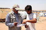 DOMIZ, IRAQ: A staff member of the NGO Qandil consults with a Syrian refugee in the Domiz refugee camp...Over 7,000 Syrian Kurds have fled the violence in Syria and are living in the Domiz refugee camp in the semi-autonomous region of Iraqi Kurdistan...Photo by Ari Jalal/Metrography