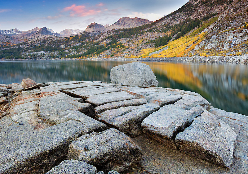 South Lake with fall colored aspens and split granite rock. Inyo National forest Eastern Sierras. California