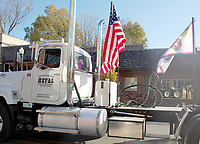 Marc Hayot/Herald Leader A truck from the Siloam Springs Metal Recycling Corporation displays the American flag and a flag that depicts the branches of the military.