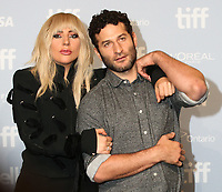 LADY GAGA AND DIRECTOR CHRIS MOUKARBEL - PHOTOCALL OF THE FILM 'LADY GAGA: FIVE FOOT TWO' - 42ND TORONTO INTERNATIONAL FILM FESTIVAL 2017 . TORONTO, CANADA, 08/09/2017. # FESTIVAL DU FILM DE TORONTO - PHOTOCALL 'GAGA : FIVE FOOT TWO'