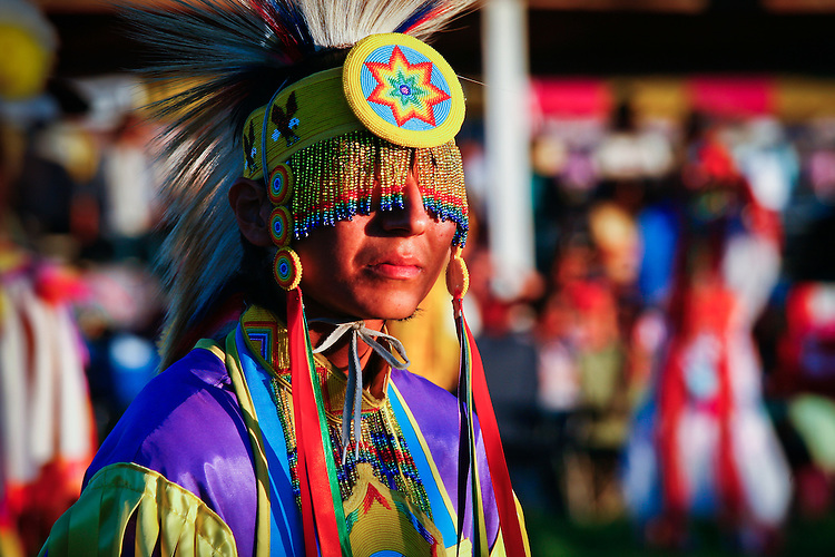 A dancers pauses between songs during the Grand Entry at Crow Fair.