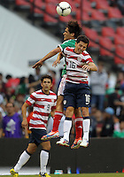 MEXICO CITY, MEXICO - AUGUST 15, 2012:  Jose Francisco Torres (16) of the USA MNT loses a header to Manuel Viniegra (6) of  Mexico during an international friendly match at Azteca Stadium, in Mexico City, Mexico on August 15. USA won 1-0.