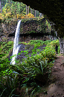Middle North Falls runs low as the rain season just begins, during the Autumn, at Silver Falls State Park in Oregon, USA.