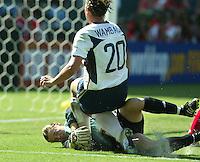 Abby Wambach is stopped by Canada's goalie, Taryn Swiatek, left, USA vs Canada, 2003 WWC Consolation Finals.