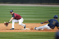 North Carolina Central Eagles shortstop Cameron Norgren (17) reaches for a throw as Justin Rodriguez (30) of the North Carolina A&T Aggies slides into second base at Durham Athletic Park on April 10, 2021 in Durham, North Carolina. (Brian Westerholt/Four Seam Images)