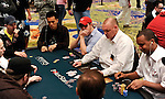 PS Qualifier Andrew Brokos (middle) sits between pros Nam Le and Phil Ivey.