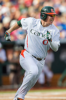 Miami Hurricanes designated hitter Zack Collins (0) runs to first base during the NCAA College baseball World Series against the Arkansas Razorbacks  on June 15, 2015 at TD Ameritrade Park in Omaha, Nebraska. Miami beat Arkansas 4-3. (Andrew Woolley/Four Seam Images)
