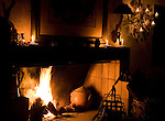 A fire in a rustic  fireplace at  Rio do Rastro Resort