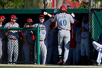 Clearwater Threshers Alec Bohm (40) is greeted by teammates and coach Chris Heintz (41) after hitting a home run during a Florida State League game against the Dunedin Blue Jays on May 11, 2019 at Jack Russell Memorial Stadium in Clearwater, Florida.  Clearwater defeated Dunedin 9-3.  (Mike Janes/Four Seam Images)
