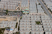 Identical rows of housing and apartments blocks in the city of Jiangyin. /Felix Features