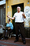 Street musicians singing Tango songs in the streets of San Telmo, Plaza Dorrego Buenos Aires Argentina 2002 2000s