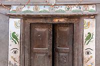 Bhaktapur, Nepal.  Door Frame with Hindu and Folk Symbols for Decoration.