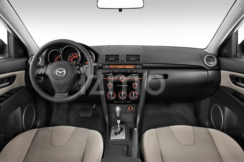 Straight dashboard view of a 2009 Mazda3 5-Door Sport.