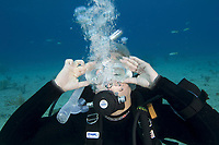 Scuba diver clearing water from mask.