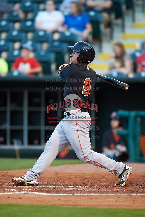Fresno Grizzles second baseman Nolan Fontana (9) hits a home run during a game against the Oklahoma City Dodgers on June 1, 2015 at Chickasaw Bricktown Ballpark in Oklahoma City, Oklahoma.  Fresno defeated Oklahoma City 14-1.  (Mike Janes/Four Seam Images)