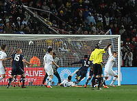 Maurice Edu scores the apparent winning goal, which was waved off by Mali referee Koman Coulibaly. Coulibaly gave American players no reason, or jersey number, for the foul. The United States came from a 2-0 halftime deficit to Slovenia to earn a 2-2 draw their second match of play in Group C of the 2010 FIFA World Cup.