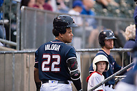 Northwest Arkansas Naturals catcher Meibrys Viloria (22) rests a batting helmet atop his hair before leaving the dugout for an at-bat on May 18, 2019, at Arvest Ballpark in Springdale, Arkansas. (Jason Ivester/Four Seam Images)