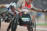 Jeff Adams of Toronto was disqualified from his heat in the men's 1500 metres, class T54, after being involved in this crash at the Paralympic Games in Beijing, Sunday, Sept., 14, 2008.    Photo by Mike Ridewood/CPC