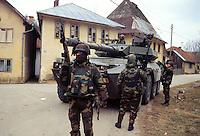 - NATO intervention in Bosnia-Herzegovina, Italian soldiers on patrol in a Serbian village....- intervento NATO in Bosnia-Herzegovina, militari italiani di pattuglia in un villaggio serbo