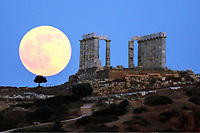 NEWS PHOTOGRAPHY A full moon rising over the ruins of the Temple of Poseidon in Sounio, Greece