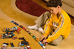 6 year old boy with collection of matchbox cars