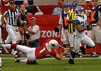 Nov. 6, 2005; Tempe, AZ, USA; Kicker (1) Neil Rackers of the Arizona Cardinals attempts to tackle running back (39) Josh Scobey of the Seattle Seahawks at Sun Devil Stadium. Mandatory Credit: Mark J. Rebilas