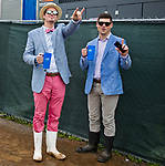 BALTIMORE, MD - MAY 19: Two men wear rain boots over their fancy suits on Preakness Day at Pimlico Race Course on May 19, 2018 in Baltimore, Maryland (Photo by Ting Shen/Eclipse Sportswire/Getty Images)