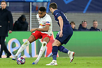 Harry Winks of Tottenham Hotspur and Christopher Nkunku of RB Leipzig during RB Leipzig vs Tottenham Hotspur, UEFA Champions League Football at the Red Bull Arena on 10th March 2020