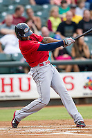 Oklahoma City RedHawks outfielder Domingo Santana (15) swings the bat during the Pacific Coast League baseball game against the Round Rock Express on August 1, 2014 at the Dell Diamond in Round Rock, Texas. The Express defeated the RedHawks 6-5. (Andrew Woolley/Four Seam Images)
