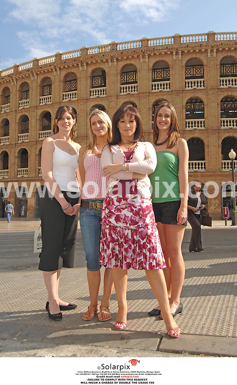 Jacqueline Gold, owner of Ann summers at her store in Valencia with three employees during filming for the brand new LIvingTV show, Break With The Boss. They are pictured at the entrance to Valencia bull ring  L to r:.Andrea Mann, white top..Eve Tucker, pink top..Jacqueline Gold..Viv Benson, green top.DATE: 13/10/2006-JOB REF: 2920-ITS