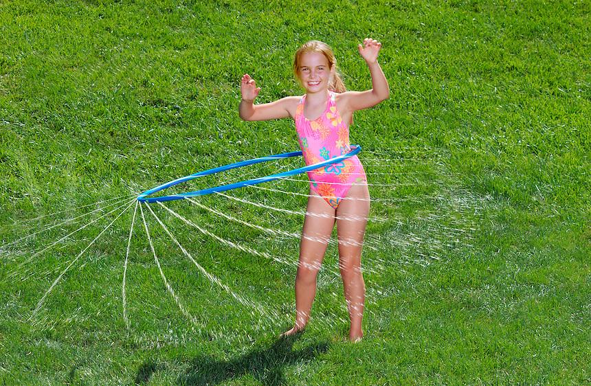 Girl with water hoolahoop.