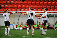 Abby Wambach celebrates her goal with Heather O'Reilly (#9, L) and Lauren Cheney (#11, R). The USA defeated Norway 2-1 at Olhao Stadium on February 26, 2010 at the Algarve Cup.