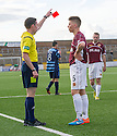 Stenny's Ciaran Summers is sent off after his second yellow card.