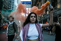NEW YORK, NY - JUNE 15: A pro-Palestinian man and woman use colored gases during a large protest in New York on June 15, 2021. The solidarity action of hundreds of pro-Palestinians is a form of support against the attacks carried out by the Israeli government. At the same time, Palestinian Prime Minister Mohammad Shtayyeh says the new Israeli government is just as bad as the old one and condemns Naftali Bennett's announcements in support of Israeli settlements. That is why the demonstrations continue in different parts of the world. (Photo by Pablo Monsalve / VIEWpress via Getty Images