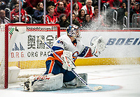 WASHINGTON, DC - JANUARY 31: Semyon Varlamov #40 of the New York Islanders  makes an ice storm save during a game between New York Islanders and Washington Capitals at Capital One Arena on January 31, 2020 in Washington, DC.