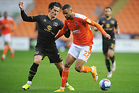 Blackpool's CJ Hamilton is tackled by Milton Keynes Dons' George Williams<br /> <br /> Photographer Kevin Barnes/CameraSport<br /> <br /> The EFL Sky Bet League One - Blackpool v Milton Keynes Dons - Saturday 24 October 2020 - Bloomfield Road - Blackpool<br /> <br /> World Copyright © 2020 CameraSport. All rights reserved. 43 Linden Ave. Countesthorpe. Leicester. England. LE8 5PG - Tel: +44 (0) 116 277 4147 - admin@camerasport.com - www.camerasport.com