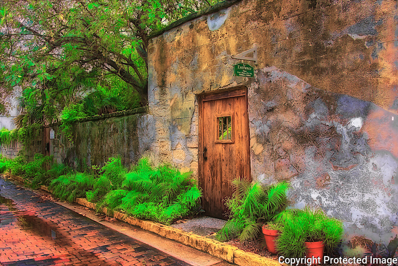 The Father O'Reilly house was built during the first Spanish Period, it is one of the oldest structures in St. Augustine. The museum is located on the oldest street in the oldest city, Aviles Street. This image is of the old wall and gate on a cloudy summer afternoon.