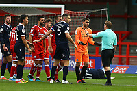 Glenn Morris of Crawley Town has words with Referee John Busby after a clash with Carlos Mendes Gomes of Morecambe during Crawley Town vs Morecambe, Sky Bet EFL League 2 Football at Broadfield Stadium on 17th October 2020