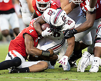 ATHENS, GA - SEPTEMBER 18: Kevin Harris #20 is stopped after a short run by Nolan Smith #4 during a game between South Carolina Gamecocks and Georgia Bulldogs at Sanford Stadium on September 18, 2021 in Athens, Georgia.